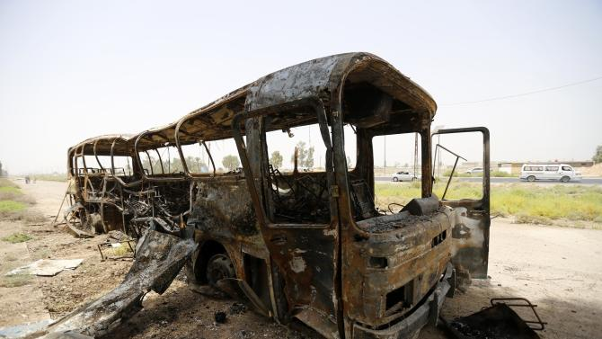 A view of a burnt bus in Taji, north of Baghdad