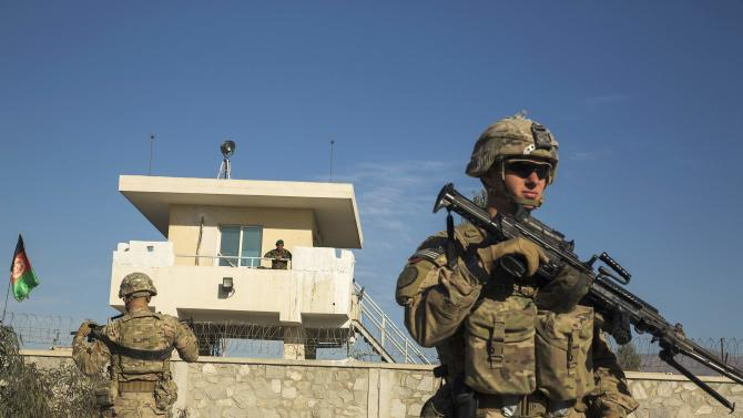A U.S. soldier from Dragon Company of the 3rd Cavalry Regiment stands in front of an Afghan National Army guard post during a mission near forward operating base Gamberi in the Laghman province of Afghanistan