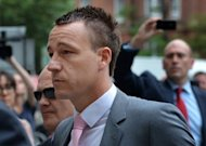 Chelsea and England footballer John Terry arrives at Westminster Magistrates court in Londonon Thursday for his trial on charges of racially abusing Anton Ferdinand during a football match last year. Terry, 31, is accused of a racially aggravated public order offence