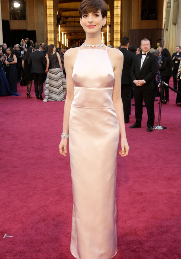 Anne Hathaway suffered an embarrassing wardrobe malfunction in her satin Prada gown which revealed a little too much ©Getty
