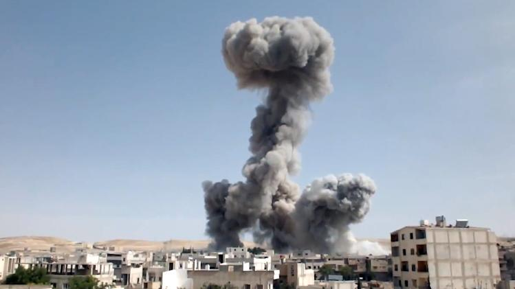 In this image taken from video obtained from the Shaam News Network, which has been authenticated based on its contents and other AP reporting, smoke rises after explosives were dropped by a Syrian government warplane in Yabroud near Damascus, Syria, Monday May 20, 2013. The Syrian regime claims there is no civil war in the country but that the army is fighting foreign-backed terrorists trying to topple Assad's government. More than 70,000 people have been killed in Syria since March 2011. (AP Photo/Shaam News Network via AP video)