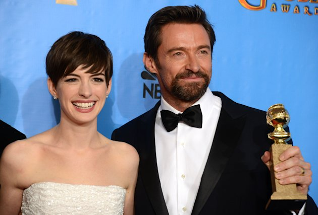 Actors Anne Hathaway, left, and Hugh Jackman pose with the award for best motion picture comedy or musical for &quot;Les Miserables&quot; backstage at the 70th Annual Golden Globe Awards at the Beverly Hilton Hotel on Sunday Jan. 13, 2013, in Beverly Hills, Calif. (Photo by Jordan Strauss/Invision/AP)