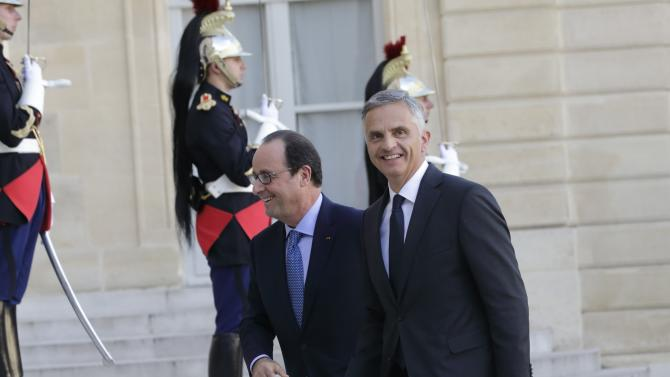 French President Hollande greets the President of the Swiss Confederation Burkhalter as he arrives at the Elysee Palace in Paris