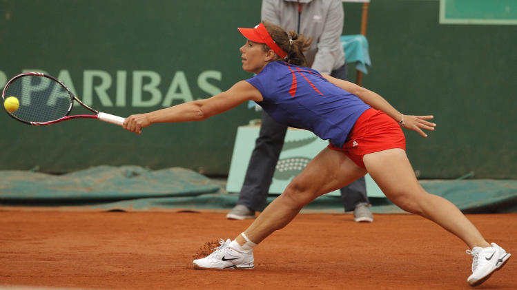 USA's Varvara Lepchenko returns the ball to Czech Repubic's Petra Kvitova during their fourth round match in the French Open tennis tournament at the Roland Garros stadium in Paris, Monday, June 4, 2012.  (AP Photo/Michel Spingler)