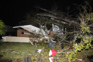 <p>               A house in the Midtown section of Mobile, Ala. is damaged after a tornado touched down Tuesday, Dec. 25, 2012. A Christmas Day twister outbreak left damage across the Deep South while holiday travelers in the nation's much colder midsection battled sometimes treacherous driving conditions from freezing rain and blizzard conditions. (AP Photo/AL.com, Mike Kittrell)  MAGS OUT