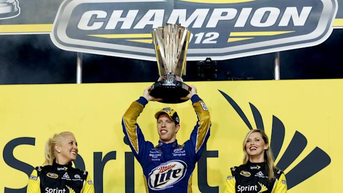 Brad Keselowski celebrates winning the NASCAR Sprint Cup Series championship at Homestead-Miami Speedway, Sunday, Nov. 18, 2012, in Homestead, Fla. (AP Photo/Terry Renna)