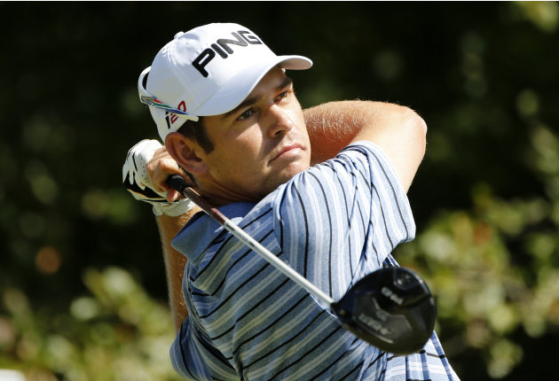 Louis Oosthuizen, of South Africa, tees off on the fourth hole during the final round of the Deutsche Bank Championship PGA golf tournament at TPC Boston in Norton, Mass., Monday, Sept. 3, 2012. (AP P