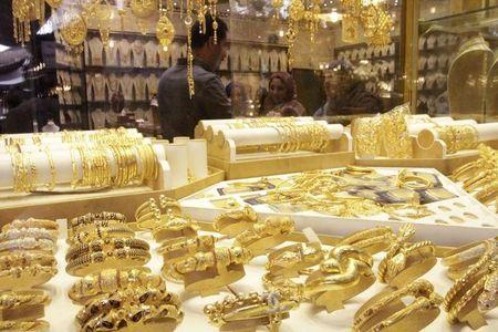 Gold set for second monthly loss as expected US rate hike drags