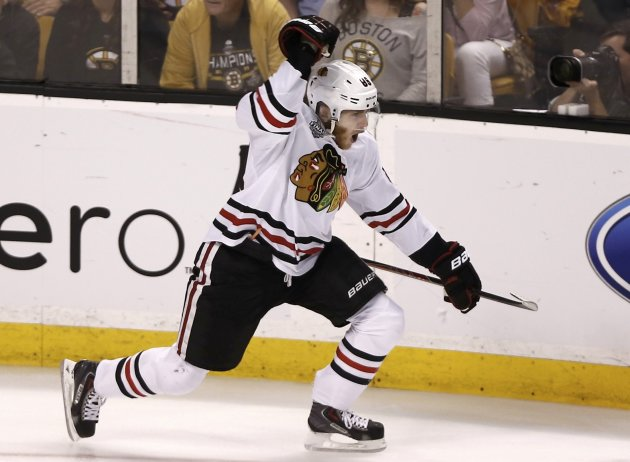 Chicago Blackhawks' Patrick Kane celebrates after scoring against the Boston Bruins during the second period in Game 4 of their NHL Stanley Cup Finals hockey series in Boston