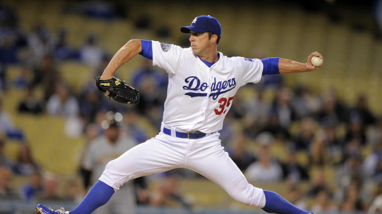 Los Angeles Dodgers starting pitcher Chris Capuano throws to the plate during the first inning of the Dodgers' baseball game against the Pittsburgh Pirates, Thursday, April 12, 2012, in Los Angeles. (AP Photo/Mark J. Terrill)