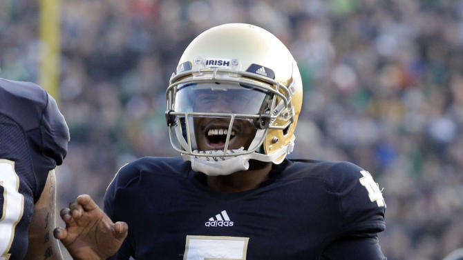 Notre Dame quarterback Everett Golson reacts after throwing for a touchdown against Wake Forest during the first half of an NCAA college football game in South Bend, Ind., Saturday, Nov. 17, 2012. (AP Photo/Michael Conroy)