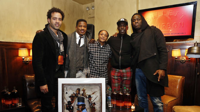 """IMAGE DISTRIBUTED FOR BULLEIT BOURBON - From left, artist Jules Arthur, actors Nate Parker, Felicia Pearson and Michael K. Williams and director Jeymes Samuel celebrate during the Bulleit Bourbon presents """"They Die By Dawn"""" film screening, Tuesday, March 19, 2013 in New York. (Photo by Jason DeCrow/Invision for Bulleit Bourbon/AP Images)"""