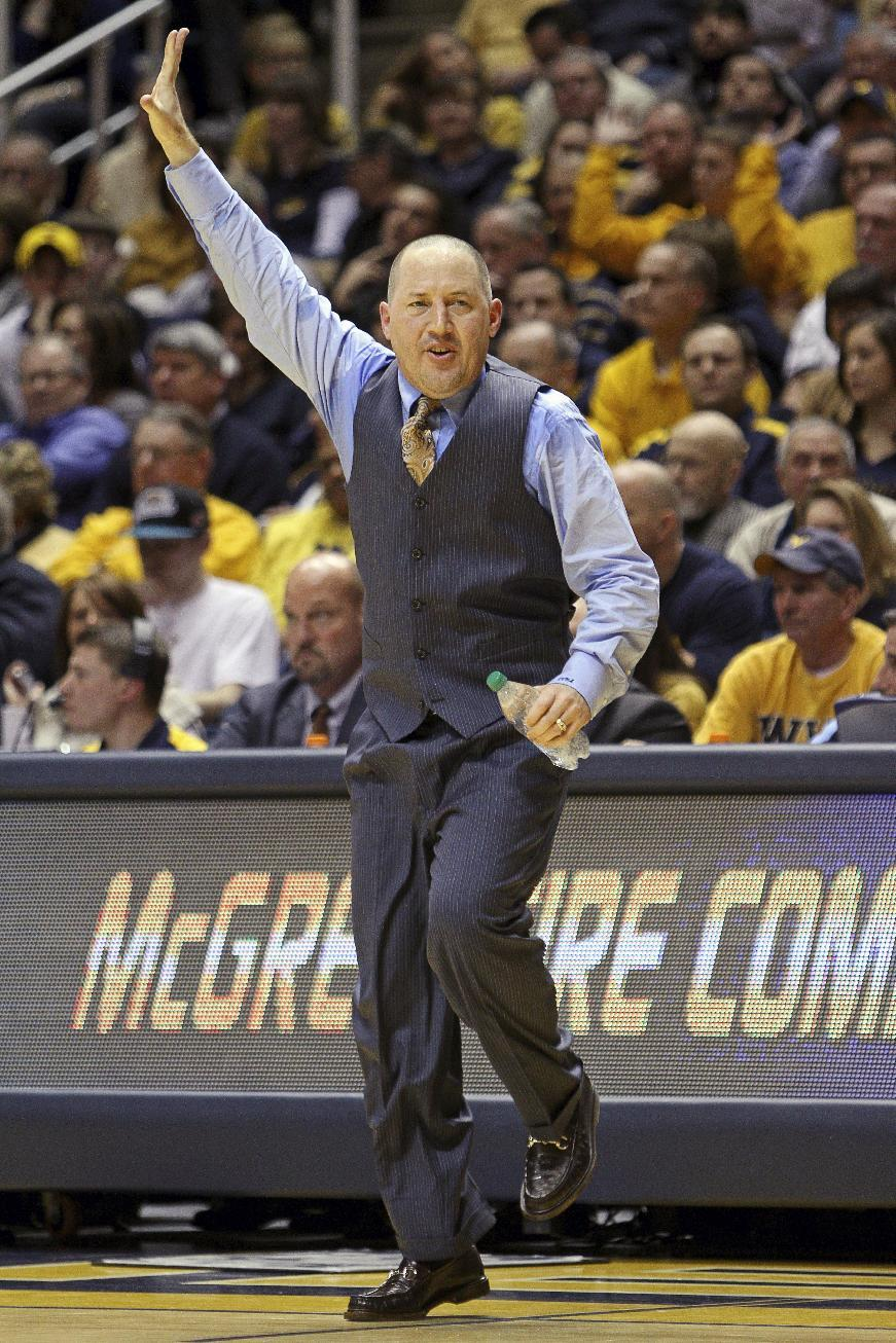 Marquette coach Buzz Williams signals to his team in the second half of an NCAA college basketball game against West Virginia in Morgantown, W.Va., on Friday, Feb. 24, 2012. Marquette won 61-60. (AP Photo/David Smith)