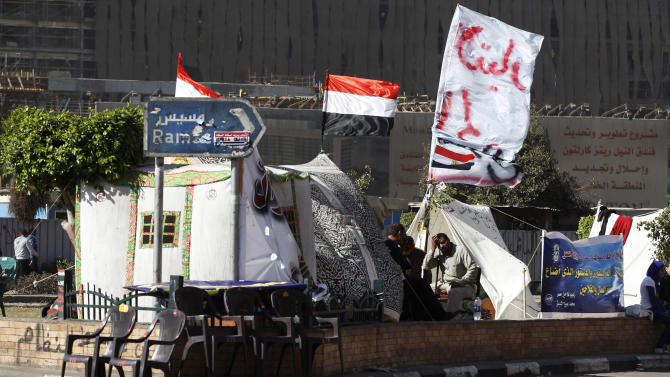 Men sit in front of their tents set in Tahrir square in Cairo, Egypt, Monday, Dec. 10, 2012. The Egyptian military on Monday assumed joint responsibility with the police for security and protecting state institutions until the results of a Dec. 15 constitutional referendum are announced. (AP Photo/Petr David Josek)