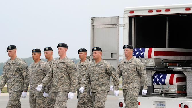 An Army carry team marches away from a vehicle holding transfer cases containing the remains of Staff Sgt. Richard L. Berry, 27, of Scottsdale, Ariz., Staff Sgt. Brandon R. Pepper, 31, of York, Pa., Pfc. Julian L. Colvin, 21, of Birmingham, Ala., and Pfc. Brenden N. Salazar, of Chuluota, Fla. Tuesday July 24, 2012 at Dover Air Force Base, Del. According to the Department of Defense, all four soldiers died in Afghanistan. (AP Photo/Steve Ruark)