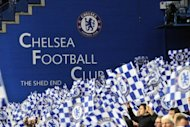 Chelsea fans wave flags before their UEFA Champions League quarter-final against Benfica at Stamford Bridge in west London, on April 4. Chelsea continued their impressive revival under interim coach Roberto di Matteo with victory over Benfica to set up a two-legged meeting with European champions Barcelona in the last four