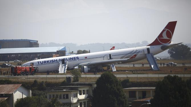 A Turkish Airlines plane lies on the field after it overshot the runway at Tribhuvan International Airport in Kathmandu