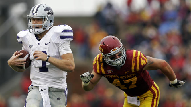 Kansas State quarterback Collin Klein, left, runs from Iowa State linebacker A.J. Klein, right, during the first half of an NCAA college football game, Saturday, Oct. 13, 2012, in Ames, Iowa. (AP Photo/Charlie Neibergall)