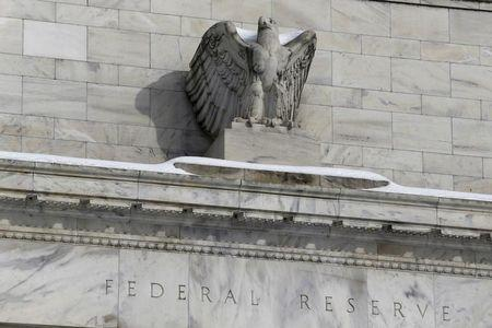 Snow rests on the eagle statue atop the U.S. Federal Reserve in Washington
