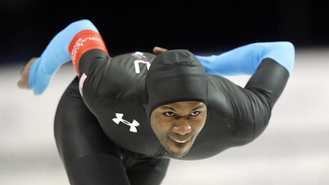 Shani Davis, of the United States, competes in the men's 1,000-meter rave during the U.S. Olympic speedskating trials Sunday, Dec. 29, 2013, in Kearns, Utah. Davis finished first. (AP Photo/Rick Bowmer)