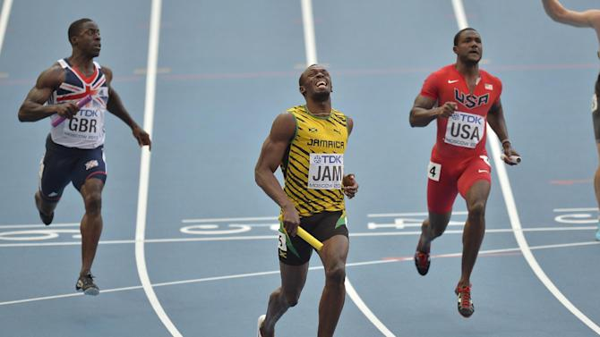 Jamaica's Usain Bolt, center, reacts after winning ahead of United States' Justin Gatlin, right, and Britain's Dwayne Chambers in the men's 4x100-meter relay final at the World Athletics Championships in the Luzhniki stadium in Moscow, Russia, Sunday, Aug. 18, 2013. (AP Photo/Martin Meissner)