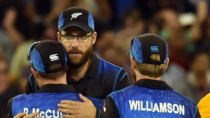 New Zealand's Daniel Vettori (C) hugs team captain Brendon McCullum (L) as Kane Williamson (R) looks on after their defeat against Australia in the Cricket World Cup final in Melbourne on March 29, 2015