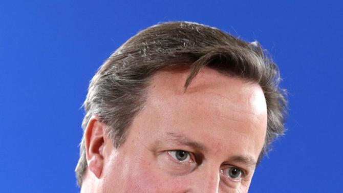 British Prime Minister David Cameron speaks during a media conference after an EU summit at the EU Council building in Brussels, on Friday, Oct. 24, 2014. Britain prime minister, David Cameron, is protesting a European Union request for an additional 2.1 billion euro ($2.65 billion) contribution to the EU coffers at a time of increasing pressure at home for the country to leave the bloc. (AP Photo/Yves Logghe)