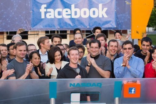 Zuckerberg (C) remotely rang the Nasdaq bell from Facebook headquarters at Menlo Park, California