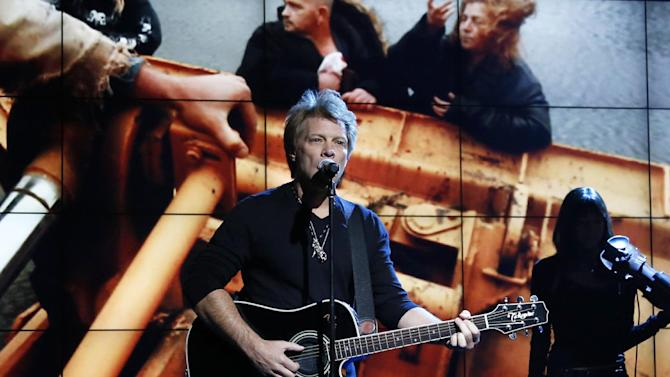 "FILE - In this Nov. 2, 2012, photo provided by NBC, Jon Bon Jovi performs in New York, during ""Hurricane Sandy: Coming Together,"" a concert hosted by NBC to raise money for victims of Superstorm Sandy. Bon Jovi, along with Paul McCartney, Bruce Springsteen & the E Street Band, Kanye West, Billy Joel, The Who and Alicia Keys will perform at another benefit concert, on Dec. 12, at Madison Square Garden in New York. Proceeds from the concert will go to the Robin Hood Relief Fund to help those affected by Sandy in New York, New Jersey and Connecticut. Sandy's assault more than two weeks ago created widespread damage and power outages throughout the area. (AP Photo/NBC, Heidi Gutman, file)"
