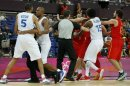 Officials try to separate the players of Spain and France after a hard foul by France's Batum during their men's quarterfinal basketball match at the North Greenwich Arena in London during the London 2012 Olympic Games