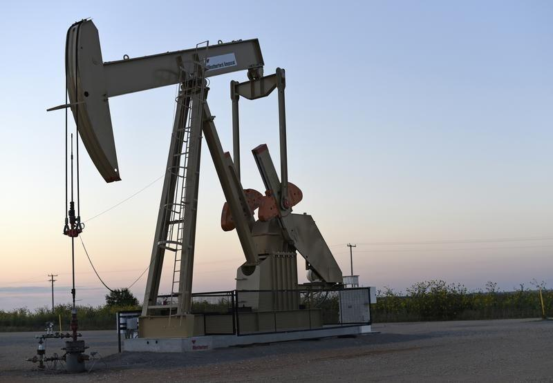 Oil up as Russia ready to talk with producers, U.S. rig count drops