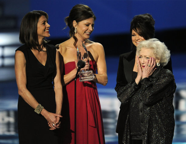 "From left, Wendie Malick, Jane Leeves, Valerie Bertinelli, and Betty White accept the award for favorite cable TV comedy for ""Hot in Cleveland"" during the People's Choice Awards on Wednesday, Jan. 11, 2012 in Los Angeles. (AP Photo/Chris Pizzello)"