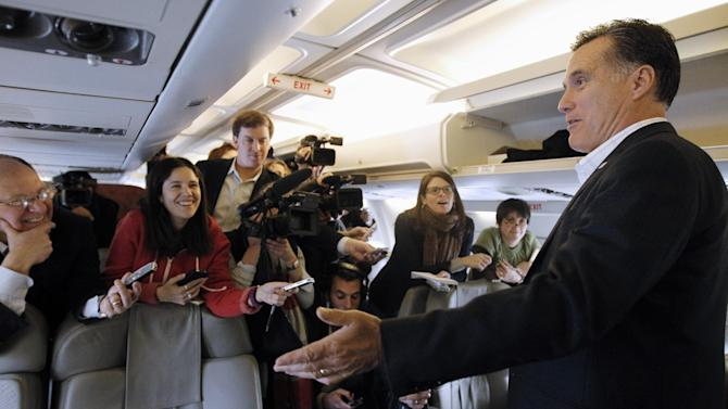 Republican presidential candidate, former Massachusetts Gov. Mitt Romney talks to reporters on his campaign charter plane in Bedford, Mass., Wednesday, Jan. 11, 2012, as he traveled to South Carolina the day after winning the New Hampshire primary election. (AP Photo/Charles Dharapak)