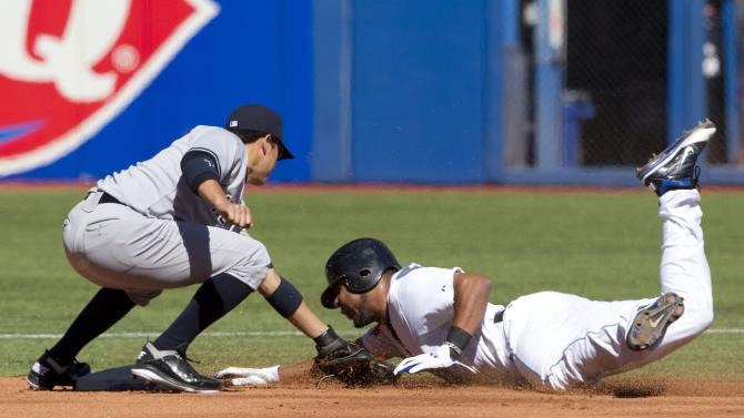 Toronto Blue Jays' Edwin Encarnacion, right, is tagged out by New York Yankees' Ramiro Pena while trying to steal second base in the second inning of MLB baseball game action in Toronto, Sunday, Sept. 18, 2011. (AP Photo/The Canadian Press, Darren Calabrese)