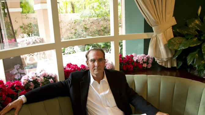 "In this April 25, 2012 photo, Robert S. Anderson, author and Beverly Hills Hotel historian, poses for a portrait inside The Polo Lounge at the Beverly Hills Hotel in Beverly Hills, Calif.  Anderson's book ""The Beverly Hills Hotel - The First 100 Years"" celebrates the 100th anniversary of the Beverly Hills Hotel. (AP Photo/Matt Sayles)"