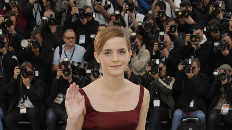 Actress Emma Watson poses for photographers during a photo call for the film The Bling Ring at the 66th international film festival, in Cannes, southern France, Thursday, May 16, 2013. (AP Photo/Francois Mori)