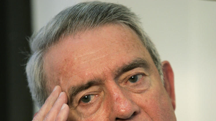 FILE - In this Nov. 6, 2006 file photo, former CBS News anchorman Dan Rather poses for a photo during an interview in his office in his New York office. CBS executives lost jobs following a 2004 story questioning President George W. Bush's National Guard service, an episode that eventually led to longtime anchor Rather's departure from the network. (AP Photo/Kathy Willens, File)