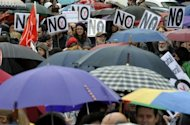 Protesters attend a demonstration organised by Union against financial cuts in health and education on April 29 in Madrid. Tens of thousands of Spaniards demonstrated in Madrid on a rainy day against new austerity measures targeting spending on education and health care
