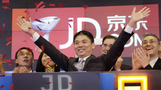 Qiangdong Liu, CEO of JD.com, raises his arms to celebrate the IPO for his company at the Nasdaq MarketSite, Thursday, May 22, 2014 in New York. JD.com, China's No. 2 e-commerce service, is headquartered in Beijing. (AP Photo/Mark Lennihan)