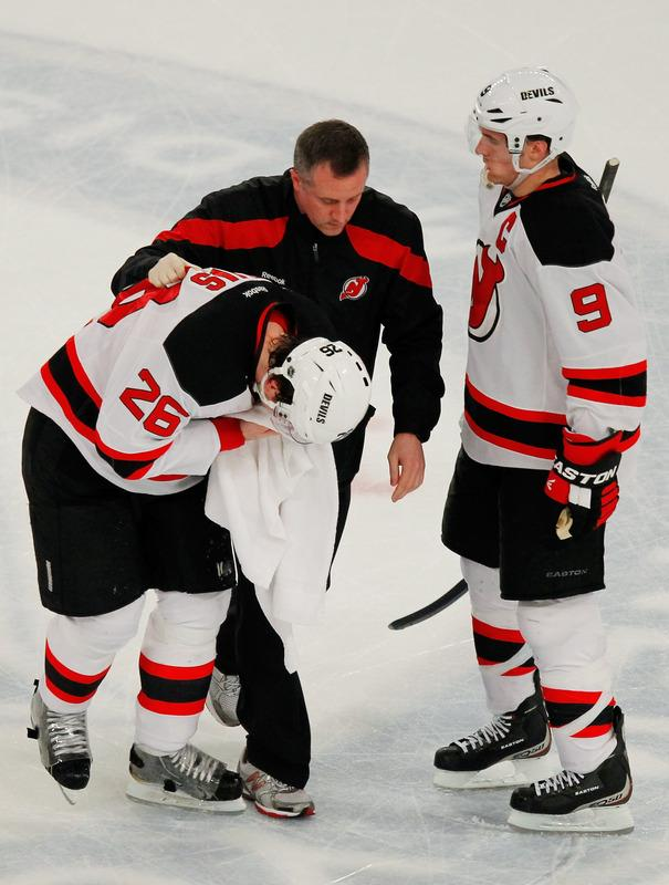 Patrik Elias #26 Of The New Jersey Devils Recieves Attention For An Injury In The First Period Of Game One Of The Getty Images