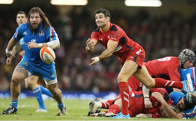 Wales's Mike Phillips passes the ball out from a scrum during their Six Nations international rugby union match between Wales and Italy at the Millennium stadium in Cardiff, Wales, Saturday, Feb.