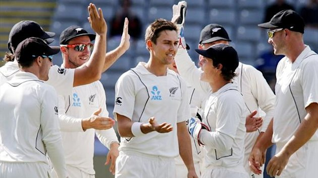 New Zealand players celebrate with Trent Boult against England (Reuters)