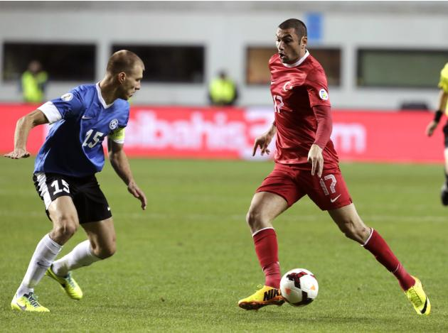 Yilmaz of Turkey dribbles past Klavan of Estonia during their 2014 World Cup qualifying soccer match in Tallinn