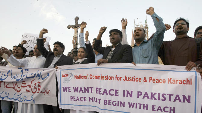 Pakistani Christians chant slogans during a demonstration to condemn the torching homes of their community by mob in Lahore, Saturday, March 9, 2013 in Karachi, Pakistan. A mob of hundreds of people in the eastern Pakistani city of Lahore attacked a Christian neighborhood Saturday and set fire to homes after hearing accusations that a Christian man had committed blasphemy against Islam's prophet, said a police officer. (AP Photo/Fareed Khan)