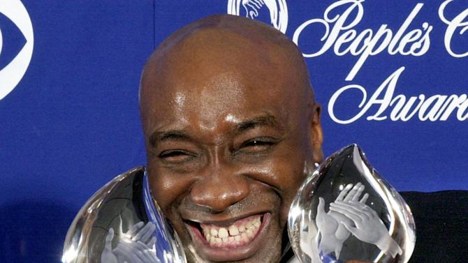 """FILE - In this Jan. 7, 2001 file photo, actor Michael Clarke Duncan shows off two awards for the film """"The Green Mile"""" at the 27th Annual People's Choice Awards in Pasadena, Calif. Duncan's fiancee says the Oscar nominee for """"The Green Mile"""" has died Monday, Sept. 3, 2012 while being hospitalized following a July heart attack. He was 54. (AP Photo/Michael Caulfield, File)"""