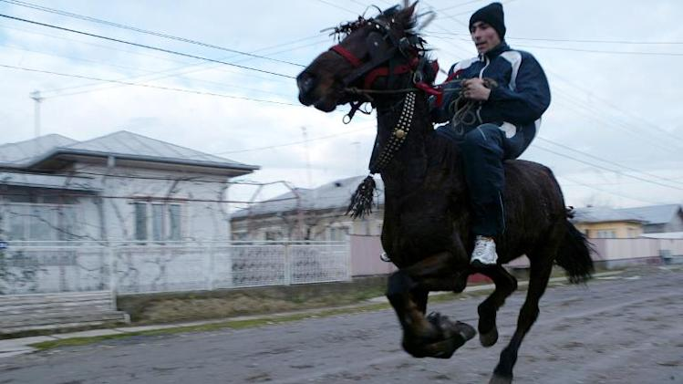 A local warms-up his horse before taking part in a race in the village of Pietrosani, 50km north from Bucharest, January 6, 2007
