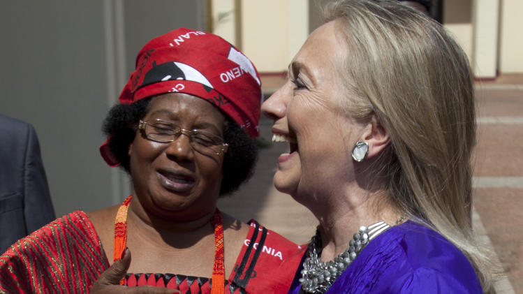 Malawi's President Joyce Banda, left, greets U.S. Secretary of State Hillary Rodham Clinton at the State House in Lilongwe, Malawi, on Sunday, Aug. 5, 2012, in the first visit to Malawi by any U.S. Secretary of State. (AP Photo/Jacquelyn Martin, Pool)
