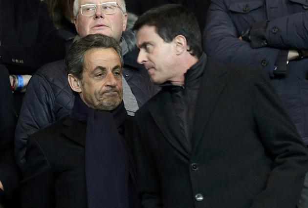 Former French President Sarkozy French Interior Minister Valls and French Interior Minister Valls attend the French Ligue 1 soccer match between Paris Saint-Germain and Olympique Marseille at the Parc