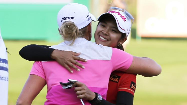 Phatlum of Thailand hugs Lewis of the U.S. at the end of the Dubai Ladies Masters golf tournament in Dubai