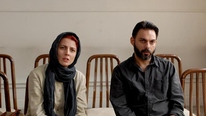 """FILE - In this publicity film image released by Sony Pictures Classics, Leila Hatami, left, and Peyman Moadi are shown in a scene from """"A Separation."""" (AP Photo/Sony Pictures Classics, Habib Madjid, Filei)"""